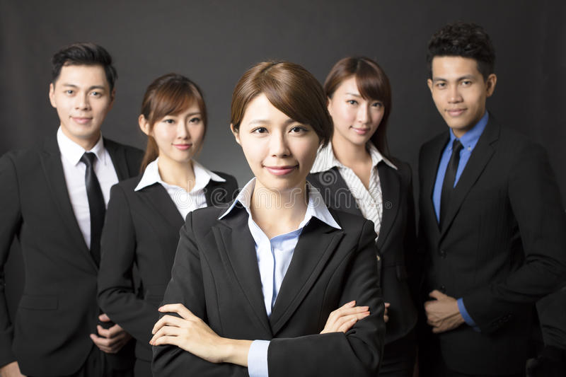Young businesswoman with successful business team. Young asian businesswoman with successful business team stock photography