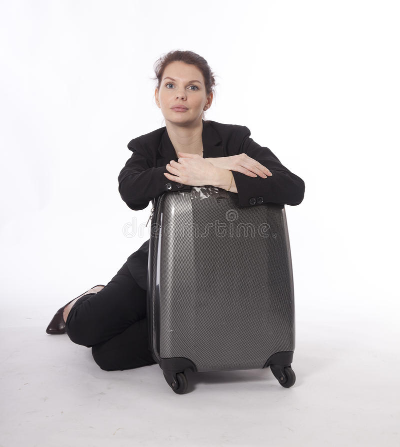 Young businesswoman with suitcase isolated stock photo