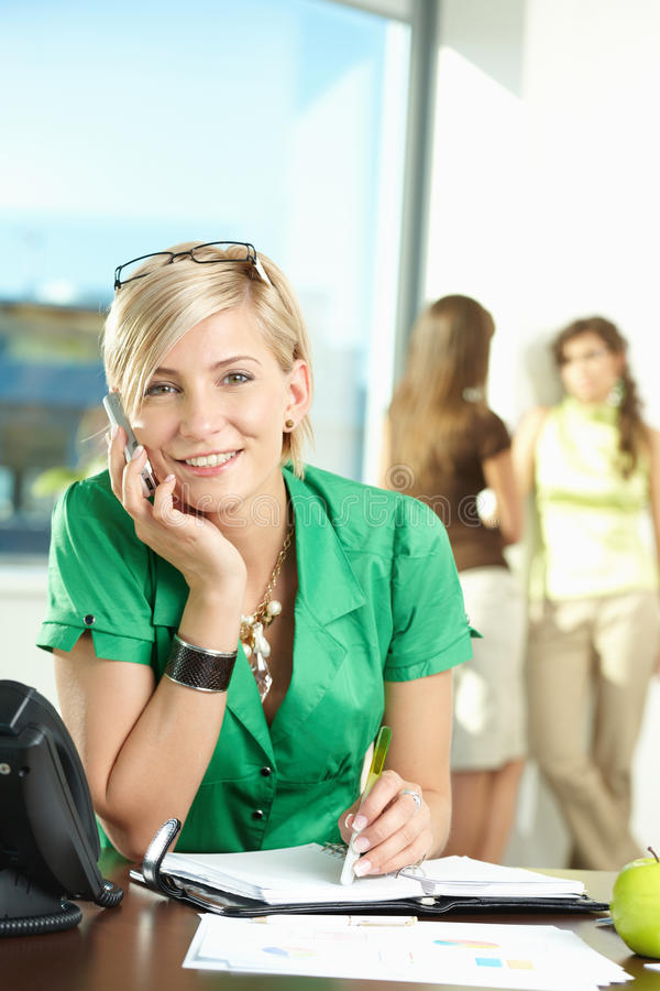 Young businesswoman talking on mobile royalty free stock image