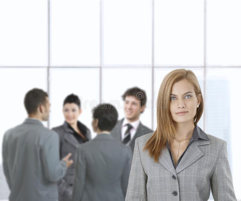Young businesswoman with team royalty free stock photo