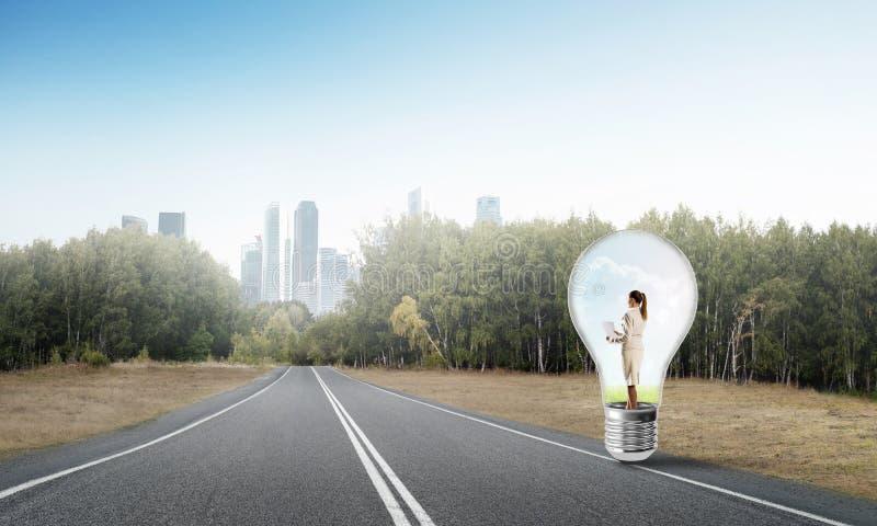 Businesswoman inside light bulb royalty free stock images