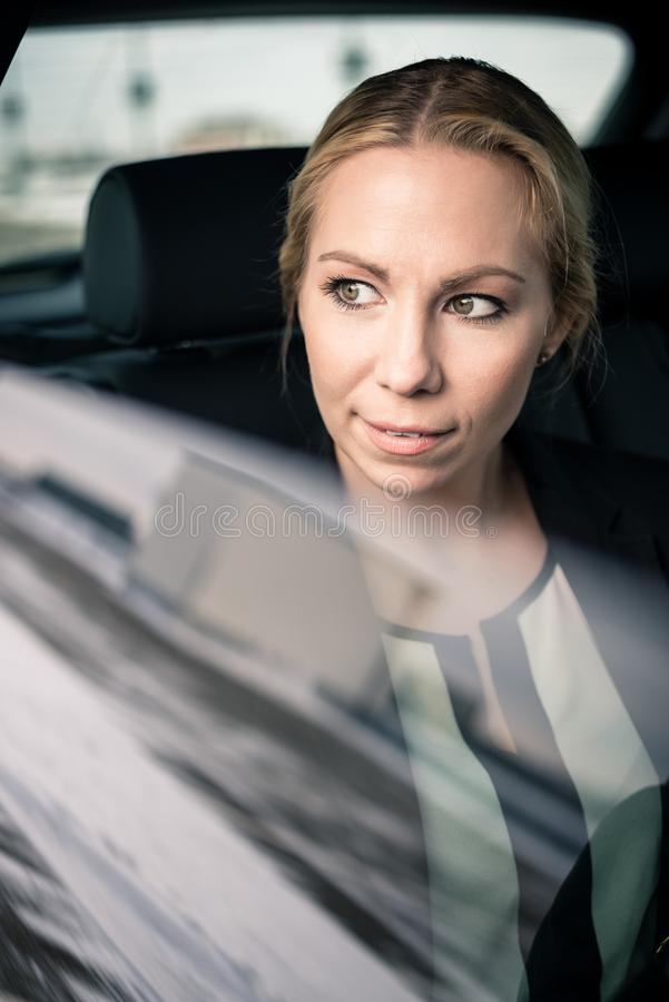 Young businesswoman travelling by car royalty free stock photo