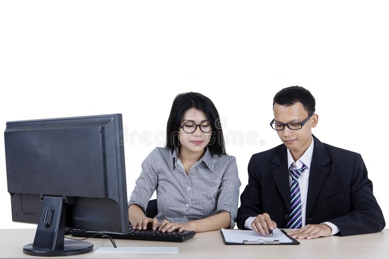 Young businesswoman working with her manager royalty free stock images