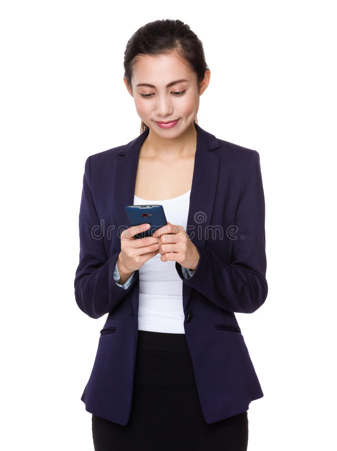 Young businesswoman use of the smartphone stock image