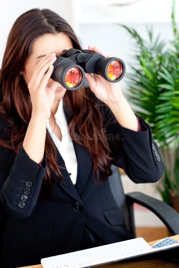 Young businesswoman using binoculars royalty free stock image