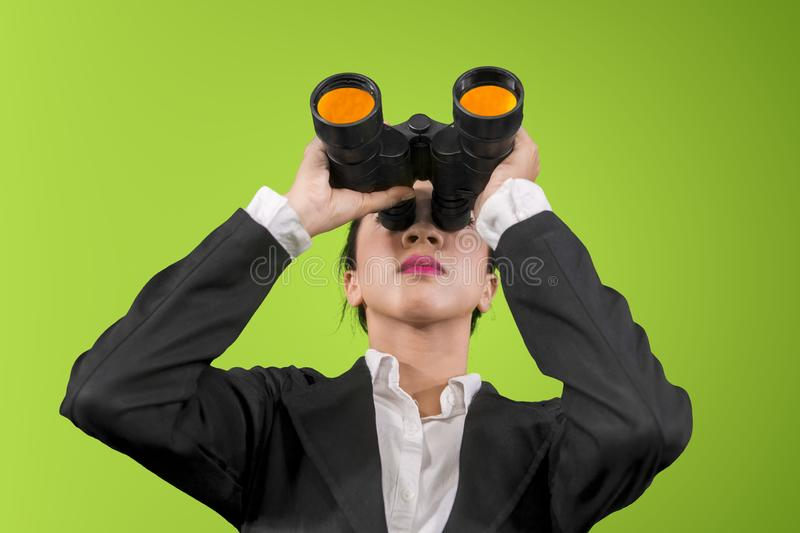 Young businesswoman using binoculars on studio stock images