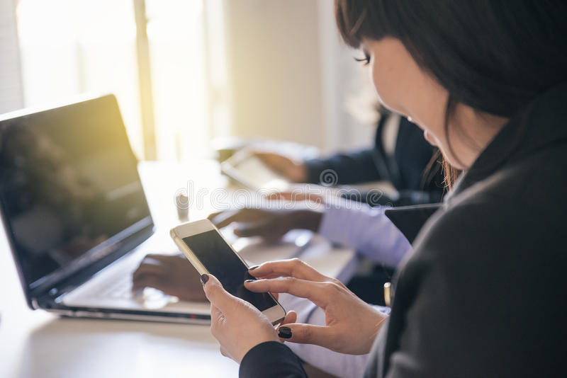 Young businesswoman using her mobile. stock photo