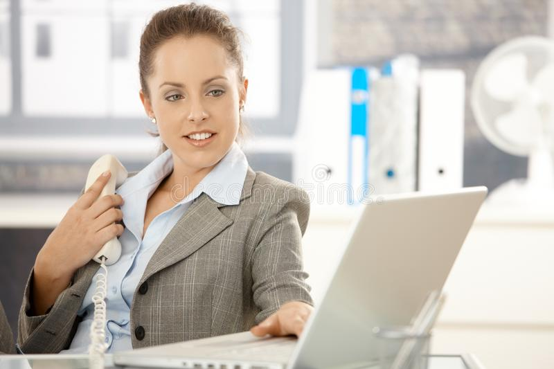Download Young Businesswoman Using Laptop In Office Royalty Free Stock Photos - Image: 17097738
