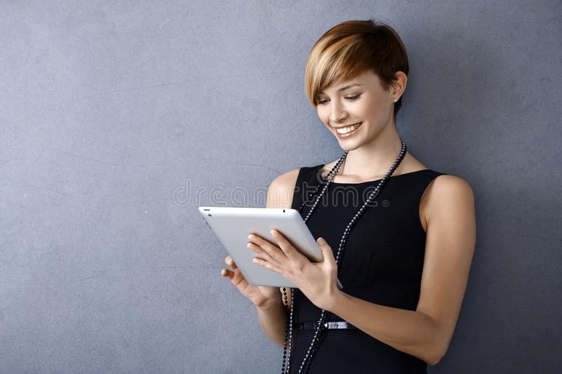 Download Young Businesswoman Using Tablet Stock Image - Image: 30710311