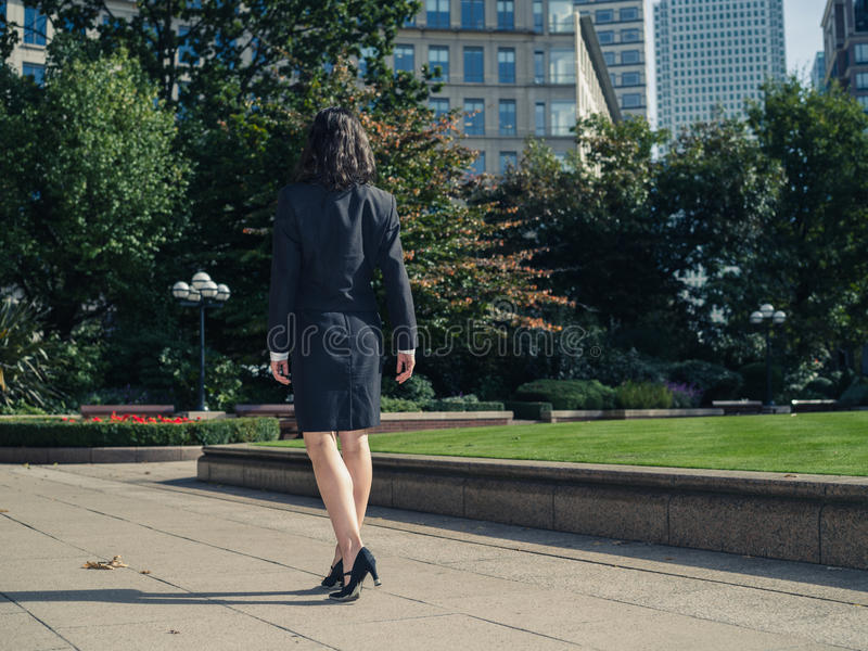 Young businesswoman walking in park royalty free stock images