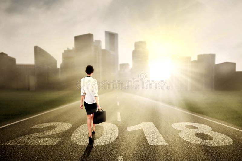Young businesswoman walking toward a city stock images
