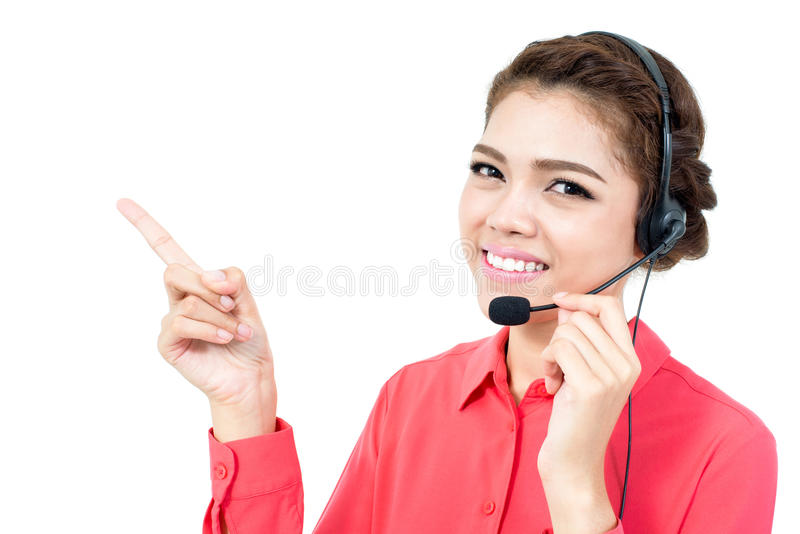 Young businesswoman wearing microphone headset as an operator stock photo
