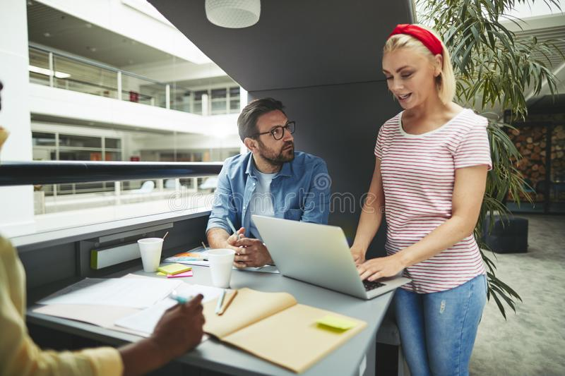 Young businesswoman working with colleagues in a office meeting stock images
