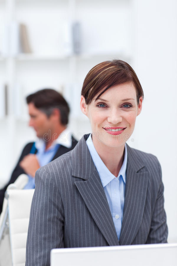 Young businesswoman working at a computer. In the office royalty free stock image