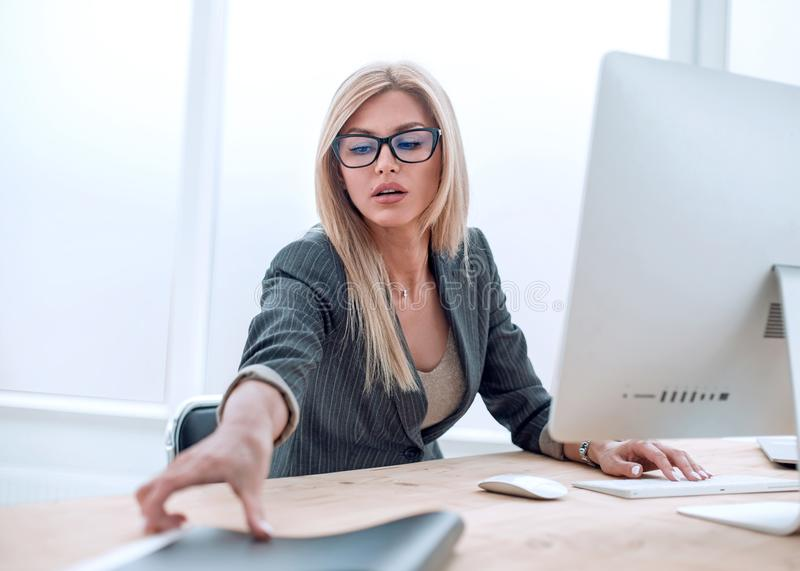 Young businesswoman working with documents in the office royalty free stock images