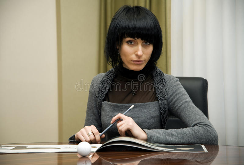 Young businesswoman working in the office royalty free stock photos