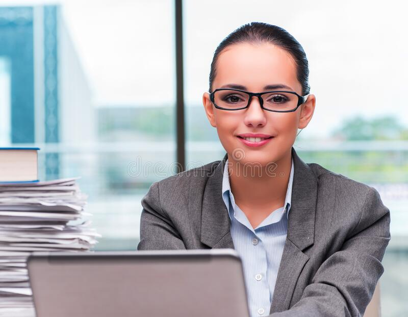 Young businesswoman working in the office stock photo