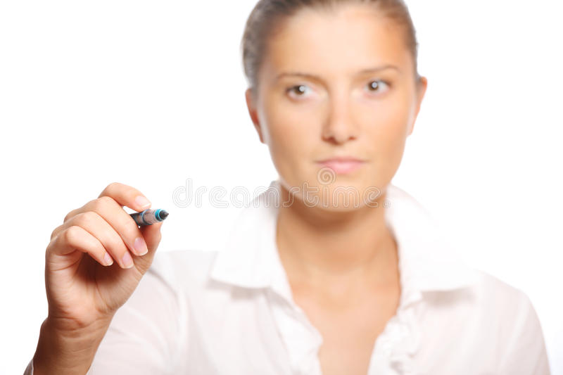 Young businesswoman writing on glass. A picture of a young businesswoman writing on glass during conference, a lot of space to put text stock photography