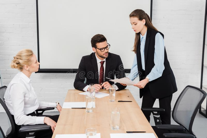 young businesswomen showing documents to their boss royalty free stock image