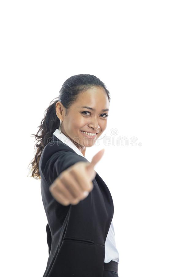 Young busineswoman giving thumbs up. Portrait of young busineswoman giving thumbs up isolated on white background royalty free stock images