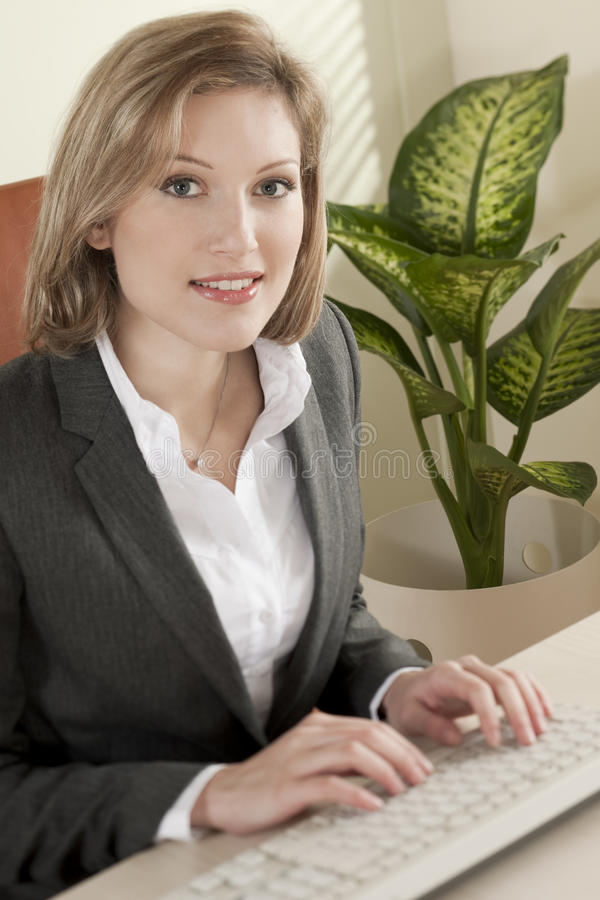 Download Young businss woman stock photo. Image of studio, suit - 16336584