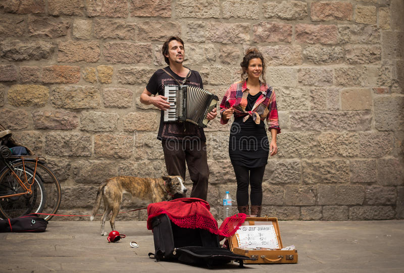Young buskers with dog playing music royalty free stock images