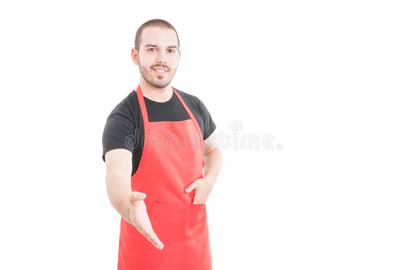 Young butcher doing handshake gesture royalty free stock photos