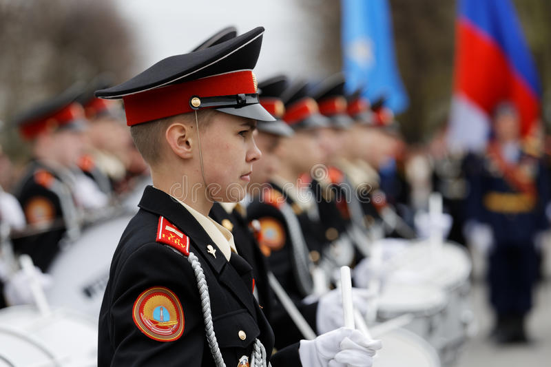 Young cadet drummer standing in line at the Victory Day parade. stock photography