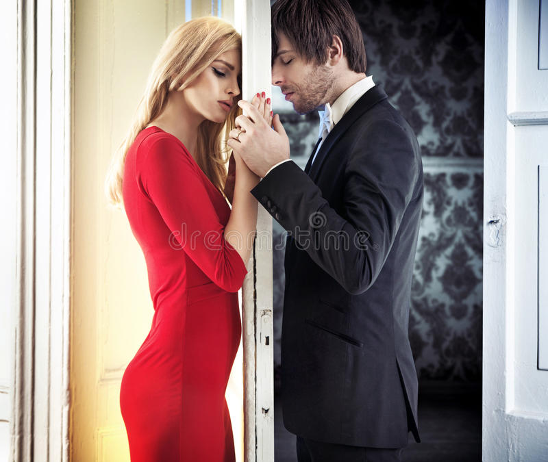 Young calm couple in romantic mood. Young attractive couple in romantic mood royalty free stock photos