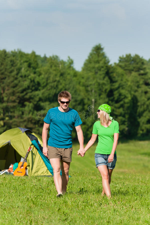 Young camping couple hold hands summer countryside royalty free stock image