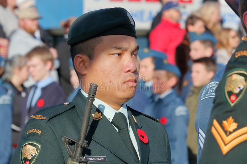 Young Canadian Soldier and Diversity. A young Canadian soldier stands at attention during Remembrance Day ceremonies in Chilliwack, BC on November 11, 2018 royalty free stock photo