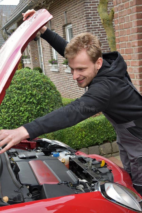 Young car mechanic at work royalty free stock photos