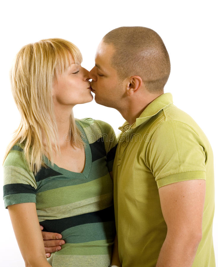Young casual couple kissing royalty free stock photography