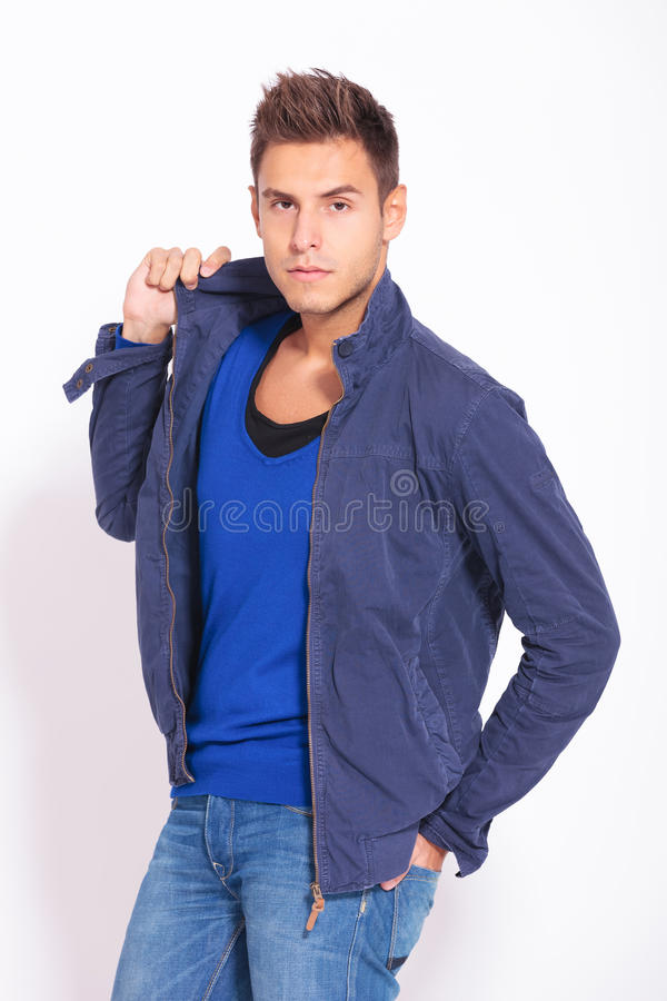 Young casual fashion man in autumn jacket royalty free stock photography