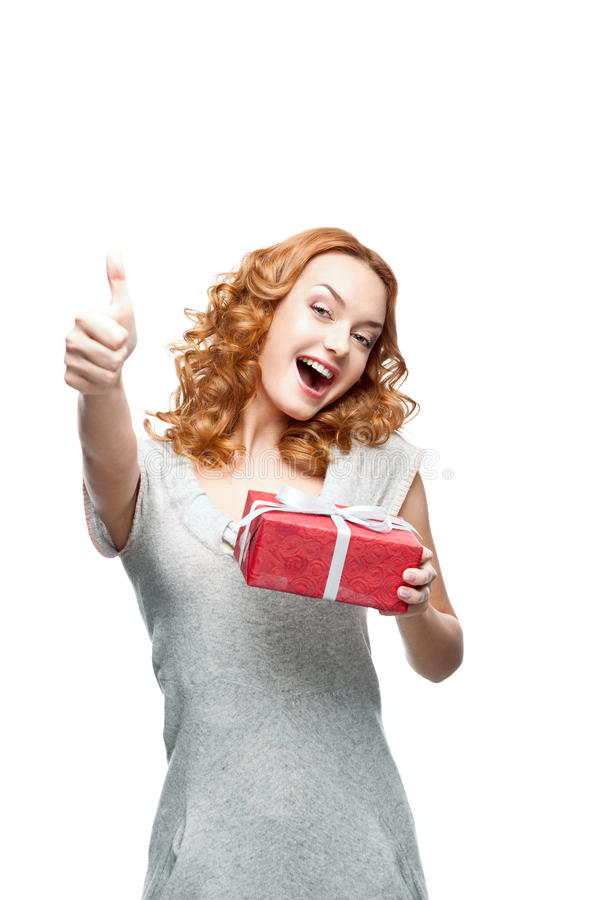 Young Casual Girl With Red Gift Showing Thumb-up Stock Photography