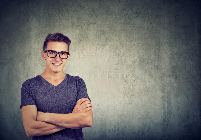Nerdy smart man in glasses stock photo