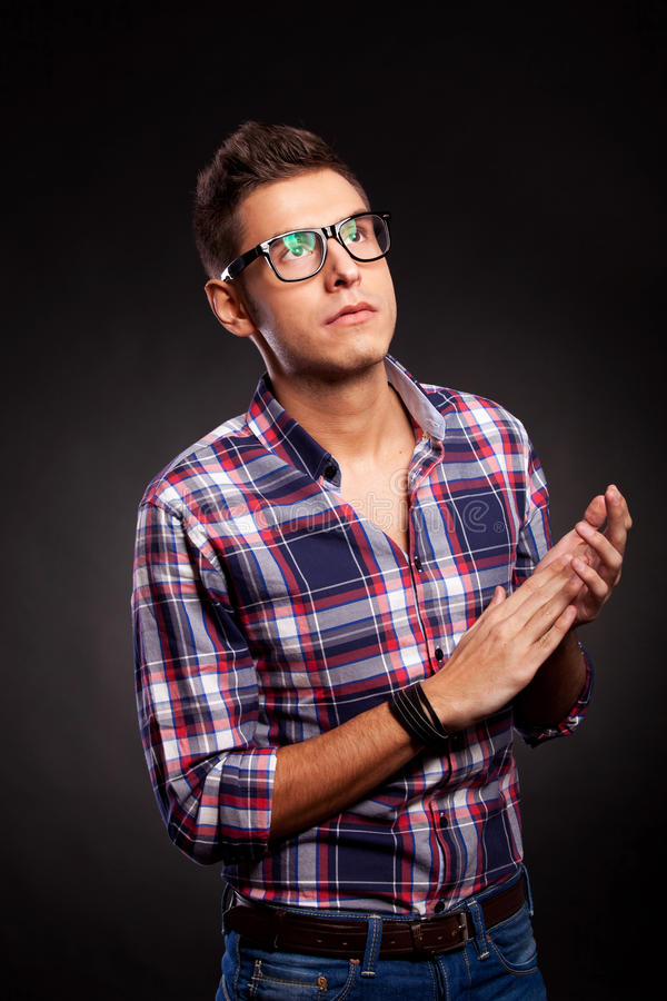 Young casual man with eyeglasses clapping