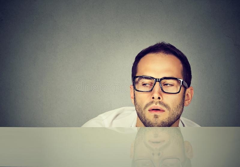 Tired office worker leaning on table royalty free stock photos