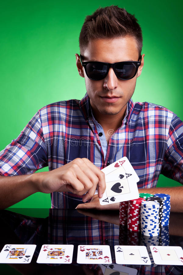 Download Young Casual Man And His Strong Poker Hand Stock Photo - Image: 26398790