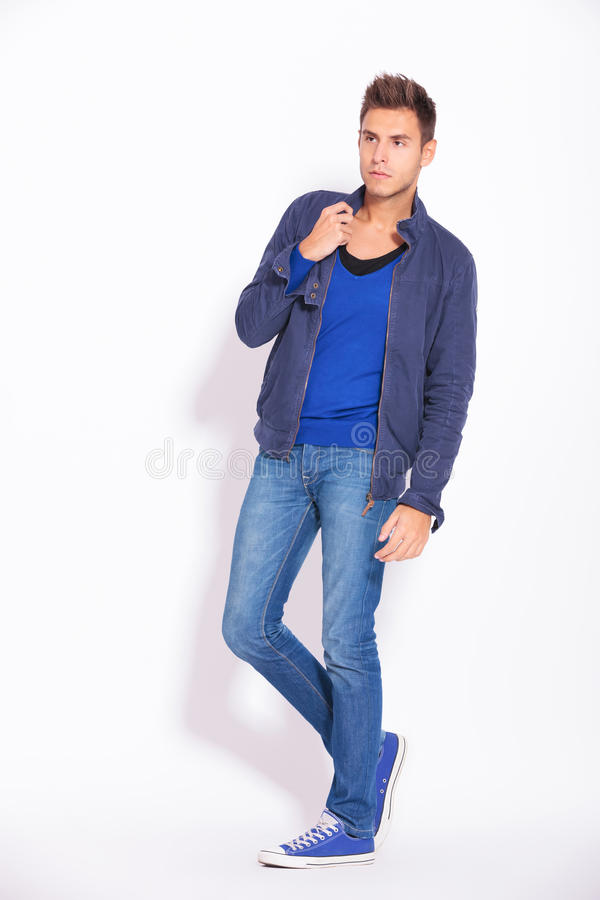 Young casual man looking away royalty free stock image