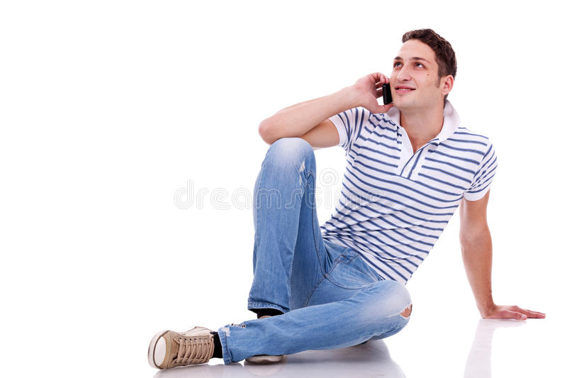 Young casual man talking on the phone stock photography