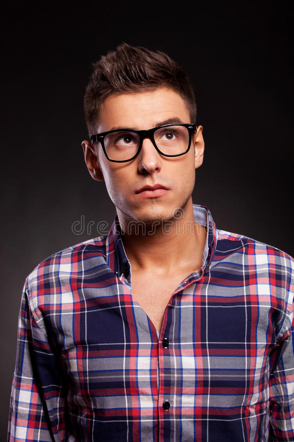 Download Young Casual Man Wearing Glasses And Looking Up Stock Photo - Image: 26398682