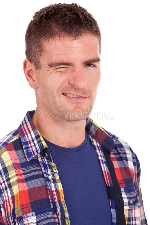 Young Casual Man Winking Royalty Free Stock Image