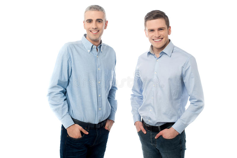 Young casual men posing in style stock photography