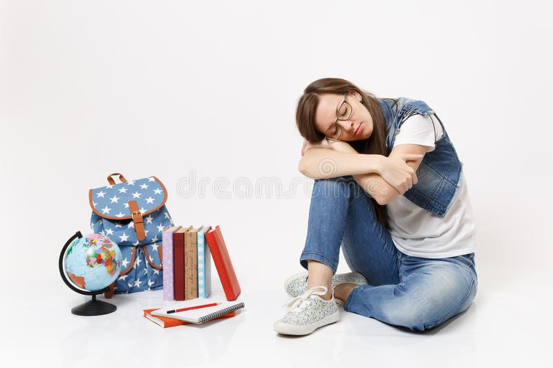 Young casual tired relaxed woman student in denim clothes glasses sleeping sitting near globe, backpack, school books royalty free stock photos