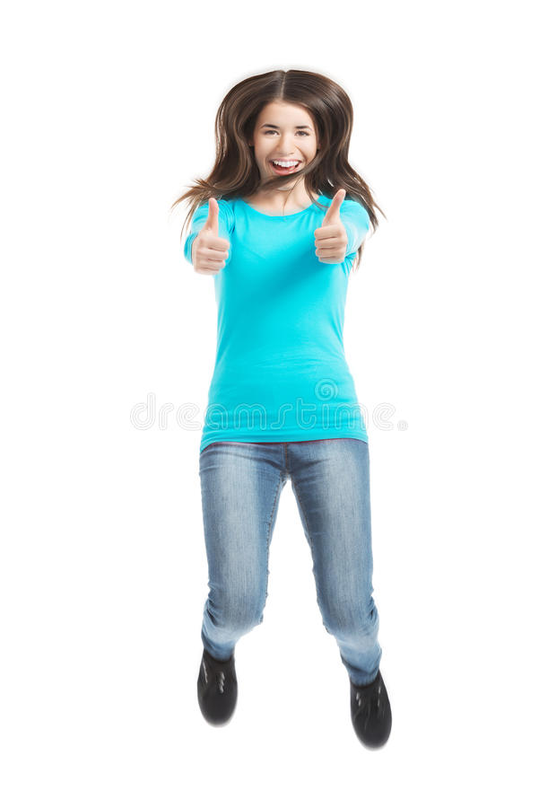 Young casual woman jumping and showing OK. stock photography