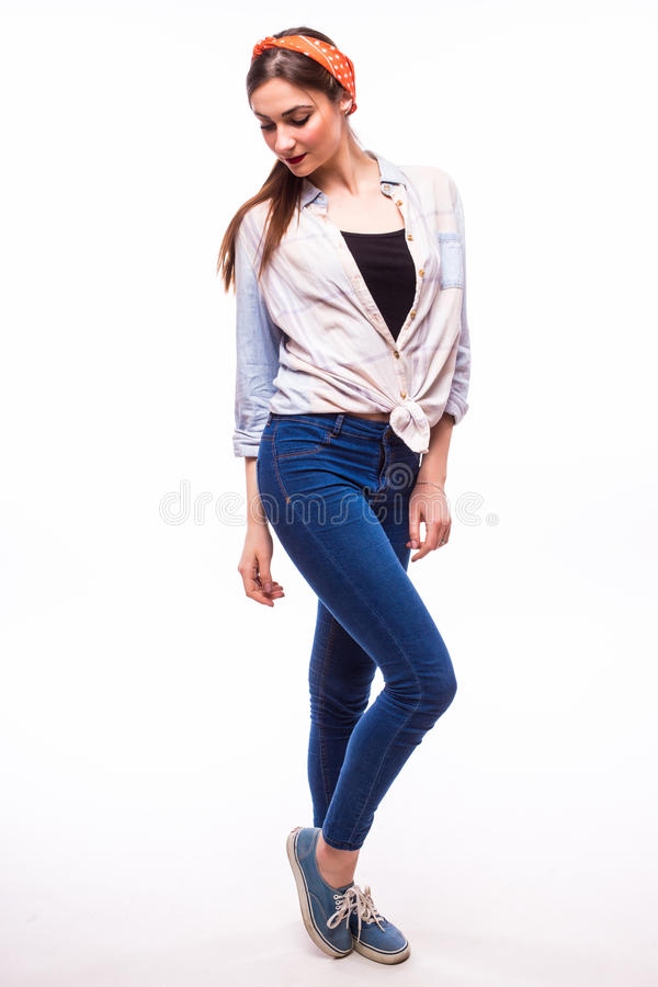 Young casual woman style over white background. studio portrait female model. royalty free stock images