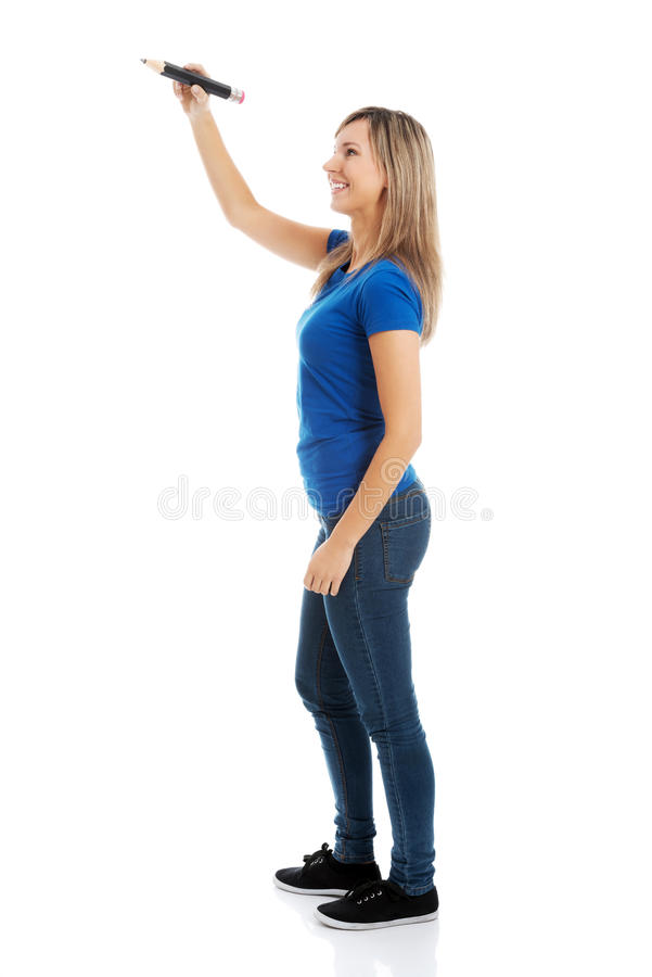 Young casual woman writing on copy space. Isolated on white royalty free stock photos