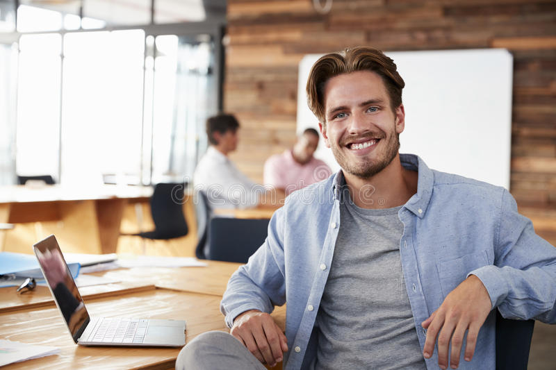 Young casually dressed white man in office looking to camera royalty free stock images