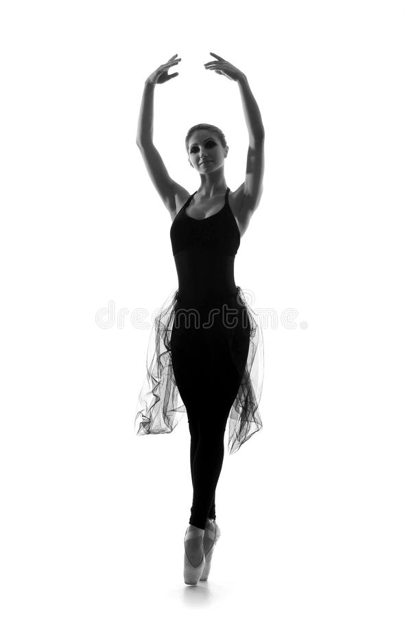 A young Caucasian ballet dancer in a black dress stock photos